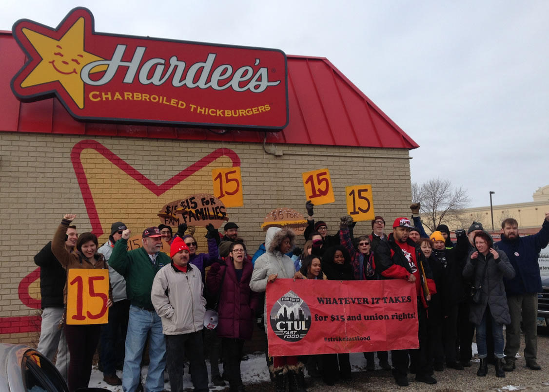 Demonstrators cheered after holding a rally against the nomination of Andrew Puzder, the CEO of the company that owns Hardee's and Carl's Jr. restaurants, for U.S. Secretary of Labor. Workday Minnesota photo