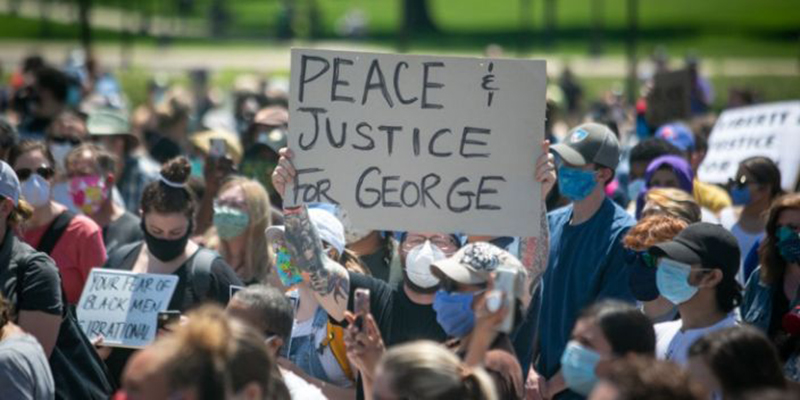 Thousands of protesters gather at the Minnesota State Capitol to demand justice for George Floyd. (Jason Armond / Los Angeles Times)