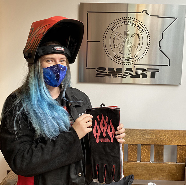 A Sheet Metal Workers Local 10 apprentice shows off her new PPE from Lincoln Electric & the Minnesota Training Partnership