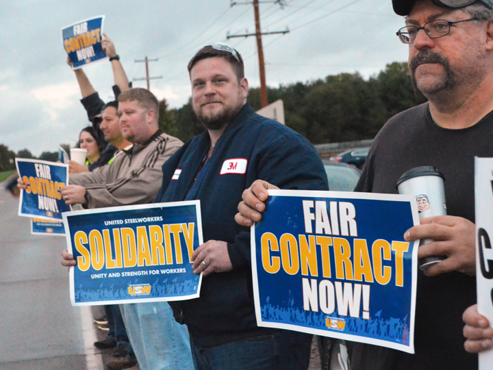 R to L: Jeff Puhl, Jeremy Hackbarth and Josh Noltin stand up for a fair contract outside 3M's Cottage Grove chemicals plant. Union Advocate photo